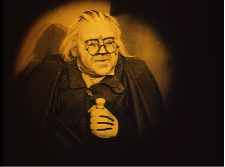 screen shot from the film of Caligari in an iris shot