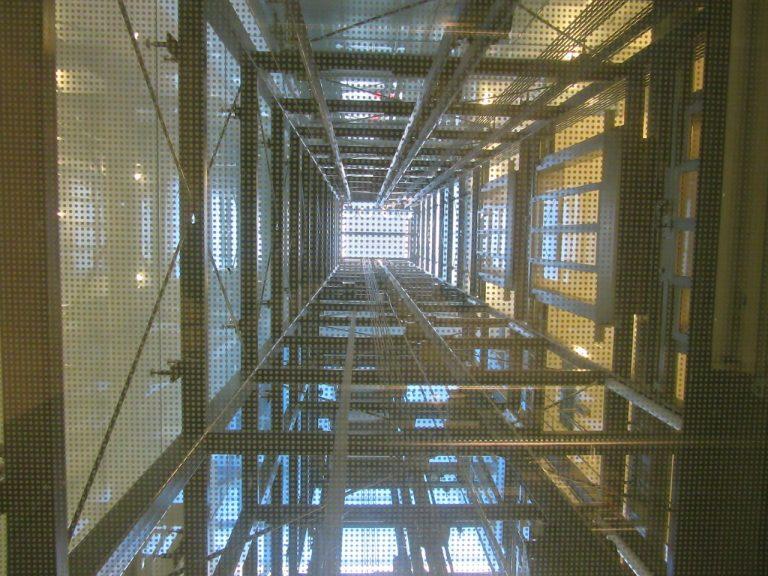 looking up through an elevator shaft towards the light